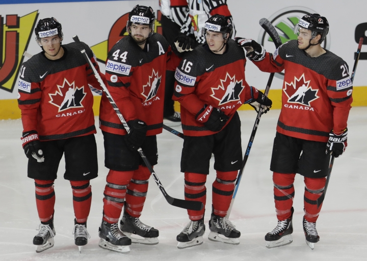 Canada's Mitch Marner, 2nd right, celebrates after scoring his sides first goal with teammates Brayden Point, right, Travis Konecny, left, and Marc-Edouard Vlasic, 2nd left, during the Ice Hockey World Championships group B match between Canada and Finland in the AccorHotels Arena in Paris, France, Tuesday, May 16, 2017. (AP Photo/Petr David Josek)