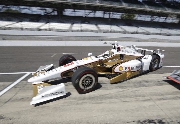 Helio Castroneves, of Brazil, pulls into the pits during a practice session for the Indianapolis 500 IndyCar auto race at Indianapolis Motor Speedway, Tuesday, May 16, 2017 in Indianapolis. (AP Photo/Darron Cummings)