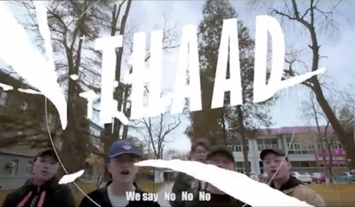 "In this undated image made from video, members of CD REV chant about THAAD, the U.S. Army's missile defense system formally known as Terminal High Altitude Area Defense. A rap group backed by China's government is warning South Korea in a music video that ""you're going too far"" with the deployment of a U.S. missile defense system, as Beijing seeks to bring its state-supported cultural forces to bear in the international dispute. (Photo via AP)"
