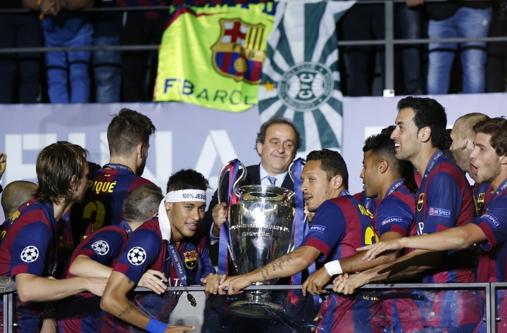 "FILE - In this Saturday, June 6, 2015 file photo, UEFA President Michel Platini prepares to hand over the trophy to Champions League winners FC Barcelona after their Champions League final soccer match against Juventus Turin at the Olympic stadium in Berlin. UEFA President Aleksander Ceferin has ended his predecessor Michel Platini's favored tradition of presenting cup-winning captains with trophies in the VIP section. UEFA said on Wednesday, May 17, 2017 Ceferin decided ""trophy presentations on the pitch will now be standard practice across all UEFA club and national team competitions."" (AP Photo/Luca Bruno, file)"
