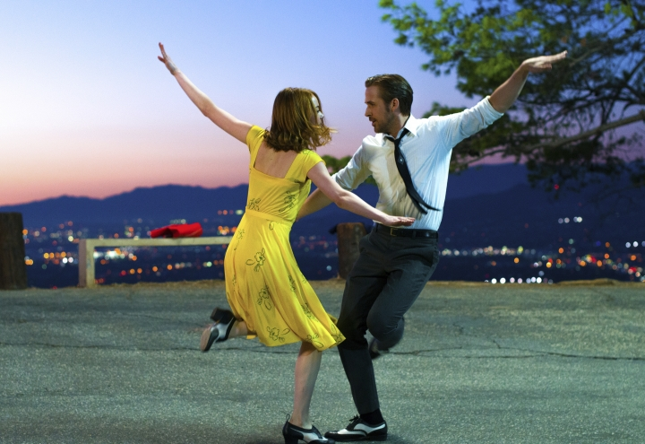 "This image released by Lionsgate shows Ryan Gosling, right, and Emma Stone in a scene from, ""La La Land."" An instrumental overture that was cut from the hit musical film starring Ryan Gosling and Emma Stone will be added for a touring concert show that kicks off this month at the Hollywood Bowl. The ""La La Land In Concert: A Live-to-Film Celebration"" is scheduled for 50 performances in the U.S. and internationally. (Dale Robinette/Lionsgate via AP)"