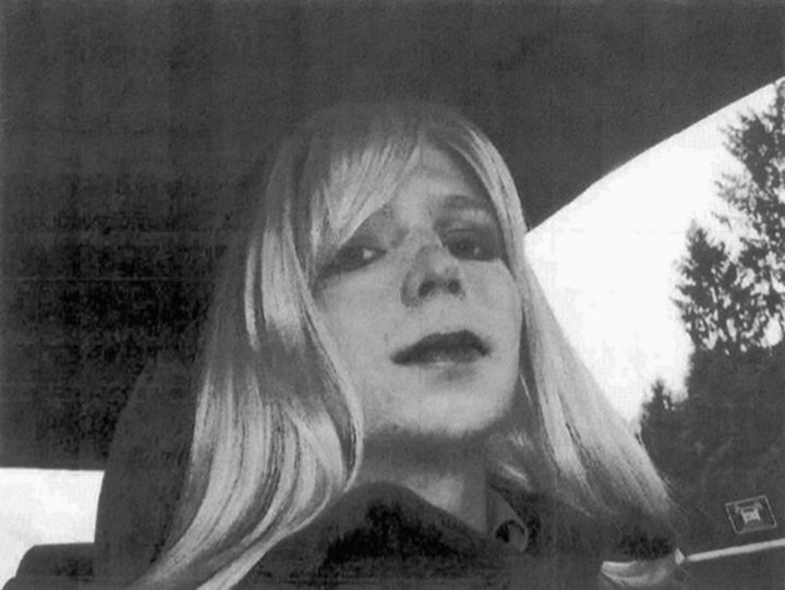FILE - In this undated file photo provided by the U.S. Army, Pfc. Chelsea Manning poses for a photo wearing a wig and lipstick. Manning, the transgender soldier convicted in 2013 of illegally disclosing classified government information, will remain on active duty in a special status after her scheduled release from prison Wednesday, May 17, 2017. (U.S. Army via AP, File)