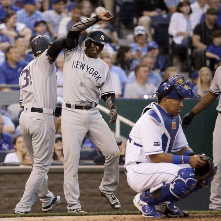 New York Yankees' Aaron Hicks, left, and Didi Gregorius celebrate after Hicks hit a three-run home run during the fourth inning of a baseball game against the Kansas City Royals, Wednesday, May 17, 2017, in Kansas City, Mo. (AP Photo/Charlie Riedel)