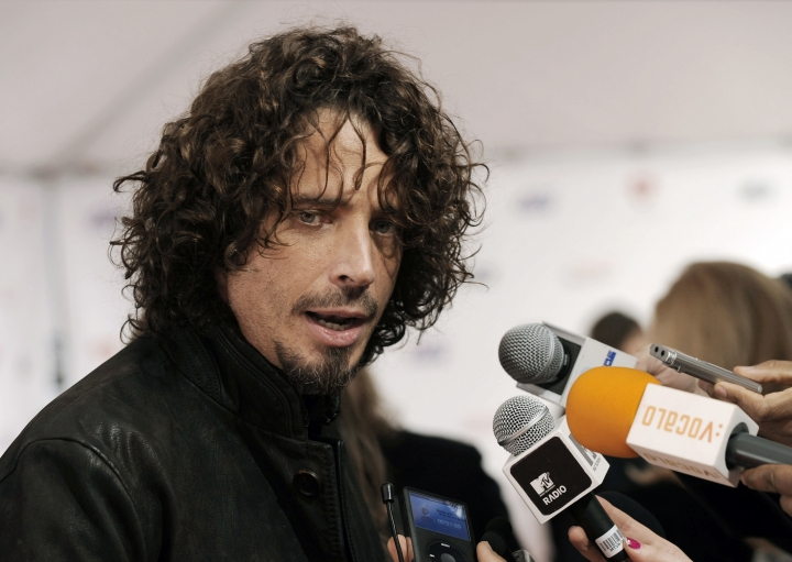FILE - In this Friday, Feb. 6, 2009, file photo, musician Chris Cornell speaks to the media as he arrives at the MusiCares Person of the Year tribute honoring Neil Diamond in Los Angeles. According to his representative, rocker Chris Cornell, who gained fame as the lead singer of Soundgarden and later Audioslave, has died Wednesday night in Detroit at age 52. (AP Photo/Chris Pizzello, File)
