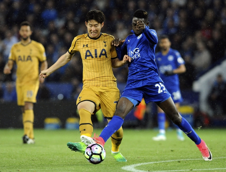 Tottenham's Son Heung-min, left, and Leicester's Wilfred Ndidi battle for the ball during the English Premier League soccer match between Leicester City and Tottenham Hotspur at the King Power Stadium in Leicester, England, Thursday, May 18, 2017. (AP Photo/Rui Vieira)