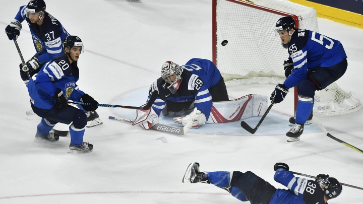 Finland's goalie Harri Sateri, center, defender Atte Ohtamaa, right, defender Juuso Hietanen, bottom, forward Mika Pyorala, background left, and forward Sebastian Aho watch the puck at the Ice Hockey World Championships quarterfinal match between the United States and Finland in the LANXESS arena in Cologne, Germany, Thursday, May 18, 2017. (AP Photo/Martin Meissner)