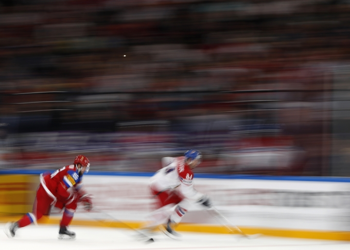 Russia's Nikita Kucherov, left, chases Czech Republic's Tomas Kundratek, right, during the Ice Hockey World Championships quarterfinal match between Russia and Czech Republic in the AccorHotels Arena in Paris, France, Thursday, May 18, 2017. (AP Photo/Petr David Josek)
