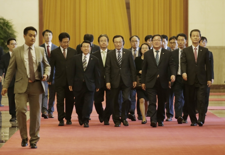 South Korea's special envoy Lee Hae-chan, center, arrives at the Great Hall of the People for a meeting with China's President Xi Jinping (unseen), in Beijing, Wednesday, May 19, 2017. (Jason Lee/Pool Photo via AP)