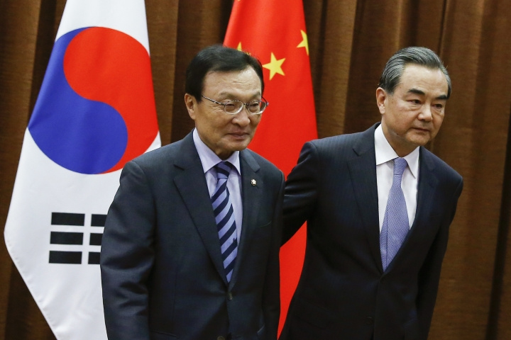 Chinese Foreign Minister Wang Yi, right, walks with South Korean special envoy Lee Hae-chan during a meeting at the foreign ministry in Beijing, China, Thursday, May 18, 2017. (Thomas Peter/Pool Photo via AP)