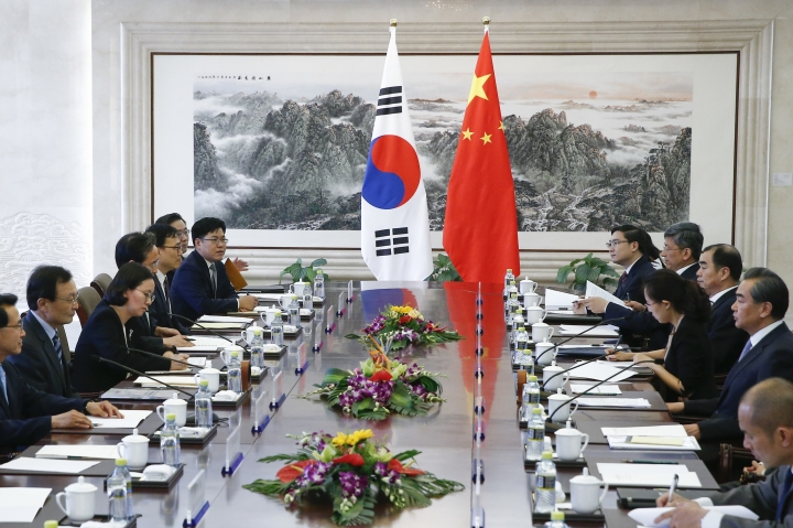 China Foreign Minister Wang Yi, right, meets South Korea's special envoy Lee Hae-chan at the foreign ministry in Beijing, Thursday, May 18, 2017. (Thomas Peter/Pool Photo via AP)
