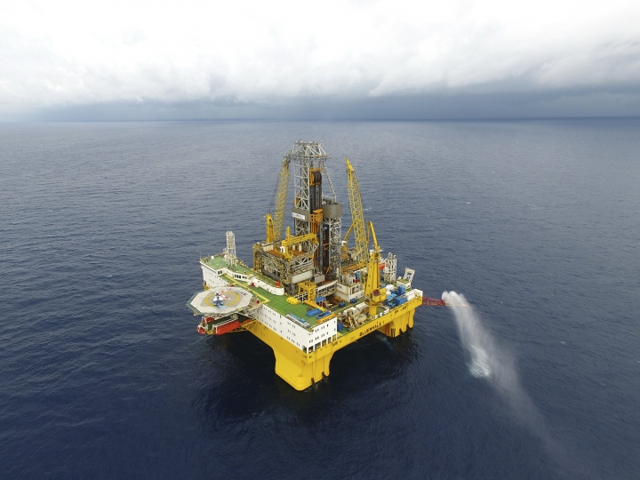 In this May 16, 2017 photo released by China's Xinhua News Agency, gas flare out from a drilling platform that extracted natural gas from combustible ice trapped under the seafloor of the South China Sea. Commercial development of the globe's vast reserves of a frozen fossil fuel known as combustible ice has moved closer to reality after Japan and China successfully extracted the material from the seafloor. (Liang Xu/Xinhua via AP)