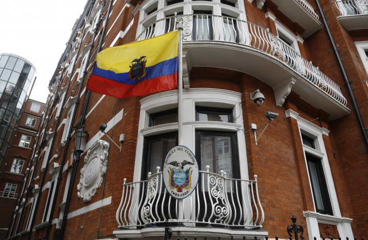The Ecuadorian national flag flies outside the Ecuadorian embassy in London, Friday May 19, 2017. Sweden's top prosecutor says she is dropping an investigation into a rape claim against WikiLeaks founder Julian Assange after almost seven years. Assange took refuge in Ecuador's embassy in London in 2012 to escape extradition to Sweden to answer questions about sex-crime allegations from two women. (AP Photo/Frank Augstein)