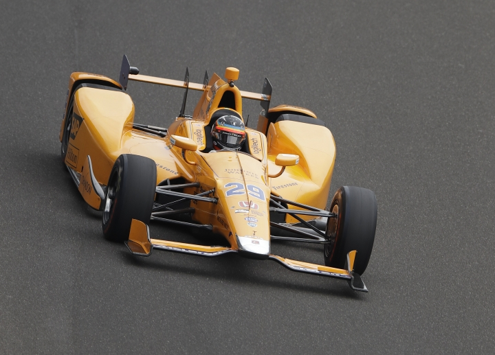 Fernando Alonso, of Spain, drives into turn one during a practice session for the Indianapolis 500 IndyCar auto race at Indianapolis Motor Speedway, Friday, May 19, 2017 in Indianapolis. (AP Photo/Darron Cummings)