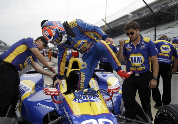 Alexander Rossi climbs out of his car during a practice session for the Indianapolis 500 IndyCar auto race at Indianapolis Motor Speedway, Friday, May 19, 2017 in Indianapolis. (AP Photo/Michael Conroy)
