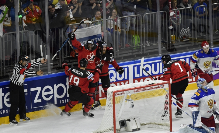 Canada's Ryan O'Reilly, center, reacts after scoring team's third goal against Russia with teammates during the Ice Hockey World Championships semifinal match between Canada and Russia in the LANXESS arena in Cologne, Germany, Saturday, May 20, 2017. (AP Photo/Martin Meissner)
