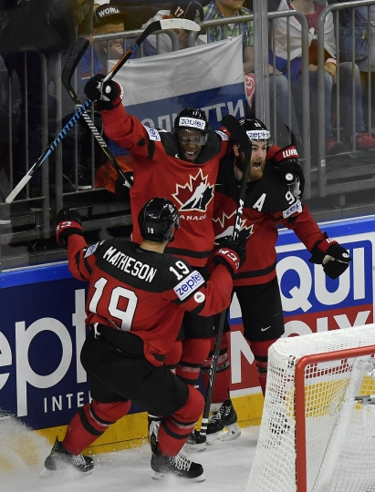 Canada's Ryan O'Reilly, right, reacts after scoring team's third goal against Russia with teammates Wayne Simmonds, center, and Mike Matheson, left, during the Ice Hockey World Championships semifinal match between Canada and Russia in the LANXESS arena in Cologne, Germany, Saturday, May 20, 2017. (AP Photo/Martin Meissner)