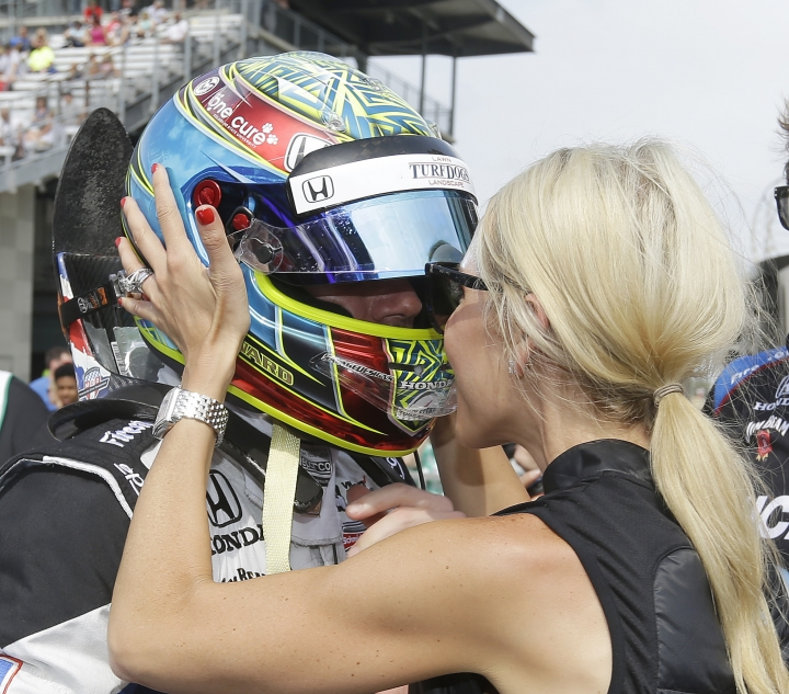 Jay Howard, of England, is congratulated by Courtney Howard during qualifications for the Indianapolis 500 IndyCar auto race at Indianapolis Motor Speedway, Saturday, May 20, 2017 in Indianapolis. (AP Photo/Michael Conroy)