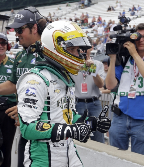 Ed Carpenter celebrates after he qualified with the fastest time during qualifications for the Indianapolis 500 IndyCar auto race at Indianapolis Motor Speedway, Saturday, May 20, 2017 in Indianapolis. (AP Photo/Michael Conroy)