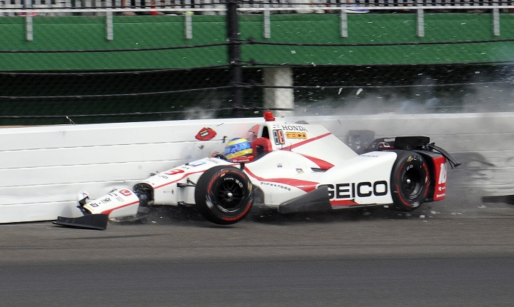 The car driven by Sebastien Bourdais, of France, impacts the wall in the second turn during qualifications for the Indianapolis 500 IndyCar auto race at Indianapolis Motor Speedway, Saturday, May 20, 2017 in Indianapolis. (AP Photo/Jamie Gallagher)