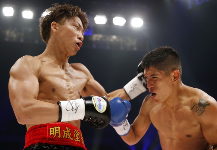 Japanese champion Naoya Inoue, left, fights with Ricardo Rodriguez in the first round of their WBO super flyweight boxing world title match in Tokyo, Sunday, May 21, 2017. Inoue knocked out Rodriguez in the third round. (AP Photo/Toru Takahashi)