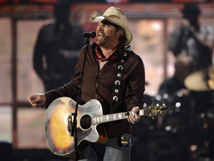 """FILE -- In this April 3, 2011 file photo, American country singer, Toby Keith performs at the 46th Annual Academy of Country Music Awards in Las Vegas, CA. Keith, known for songs such as """"Whiskey Girl"""" and """"Beer For My Horses,"""" is scheduled to perform in the Saudi capital, Riyadh, Saturday, May 20, 2017, in an event that coincides with President Donald Trump's first overseas visit. Saudi entertainment website Lammt, which is advertising the event, says the free concert, which will also feature an Arabian lute player, is open to men only. (AP Photo/Julie Jacobson, File)"""