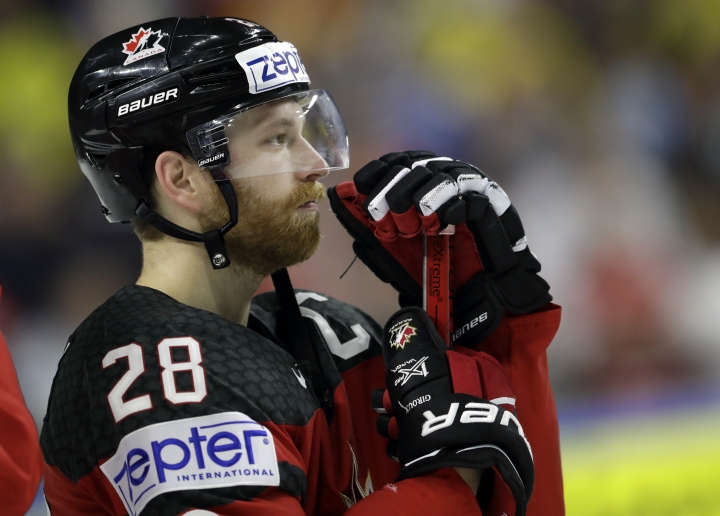 Canada's Claude Giroux reacts in dejection after defeat in the Ice Hockey World Championships final match between Canada and Sweden in the LANXESS arena in Cologne, Germany, Sunday, May 21, 2017. (AP Photo/Petr David Josek)