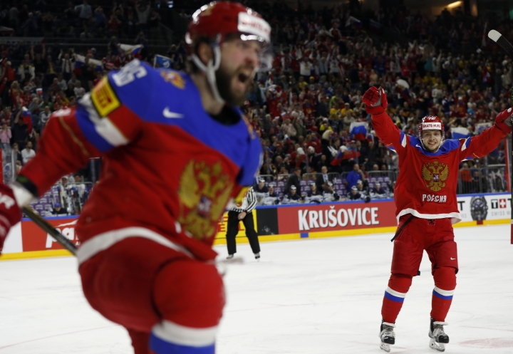 Russia's Nikita Kucherov, left, celebrates after scoring a goal with Russia's Artemi Panarin, right, during the Ice Hockey World Championships bronze medal match between Russia and Finland in the LANXESS arena in Cologne, Germany, Sunday, May 21, 2017. (AP Photo/Petr David Josek)