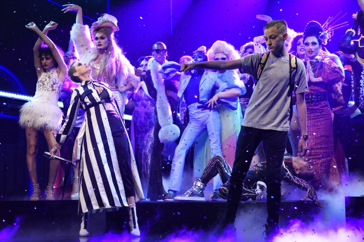 "In this Saturday, May 20, 2017, photo provided by NBC, Russell Horning dances on stage alongside Katy Perry during her performance of ""Swish Swish"" on ""Saturday Night Live"" in New York. Horning, an Instagram dancing sensation has gone from online to on-air after Perry invited him to show off his moves during her ""Saturday Night Live"" performance. (Will Heath/NBC via AP)"
