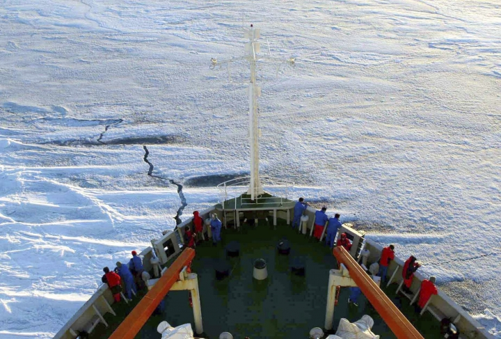 FILE - In this Dec. 17, 2005 file photo released by Xinhua News Agency, members of the Chinese Antarctica Research Team wait for the arrival at the continent on board of the polar expedition ship Xuelong, one day before the team on its 22nd expedition trip to the polar continent arriving the icy region nearby the Chinese Zhongshan station after one-month sailing. Chinese officials will detail their growing ambitions in Antarctica on Monday, May 22, 2017, as Beijing hosts a meeting of nations that oversee management of the polar region amid concerns over its susceptibility to climate change. Scientific research in Antarctica is governed under a 1959 treaty that designates the ice-capped continent as a natural reserve and prohibits commercial resources extraction. (Zhang Zongtang/Xinhua News Agency via AP)