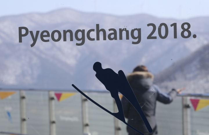 FILE - In this Feb. 10, 2017 file photo, a woman stands at the top of the Alpensia Ski Jumping Centre, the venue for the Ski Jumping and Nordic Combined events of the 2108 Pyeongchang Winter Games during the media tour in Pyeongchang, South Korea. The opening ceremony for the Olympic winter games will be held on Feb. 9, 2018. (AP Photo/Lee Jin-man, File)
