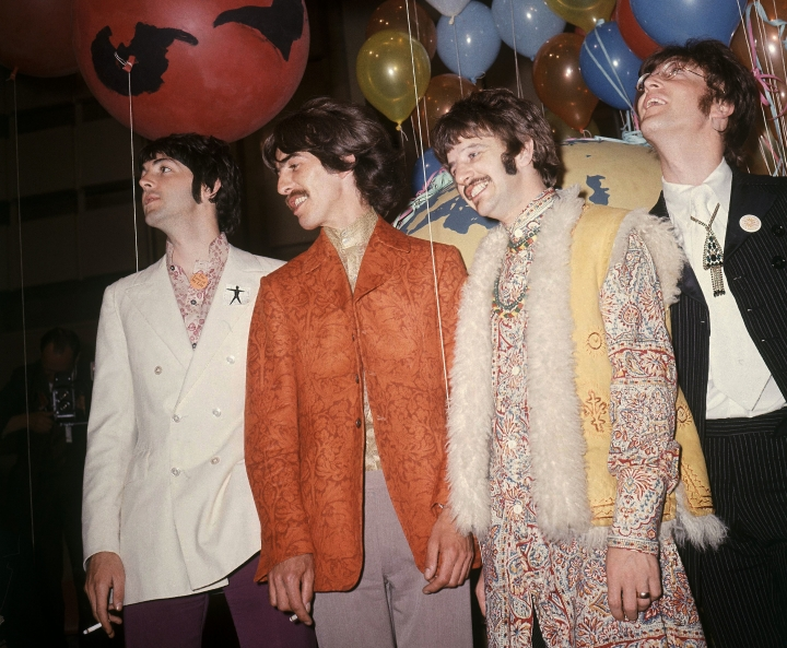 """FILE - In this June 1967 file photo, Paul McCartney, from left, George Harrison, Ringo Starr and John Lennon of The Beatles appear backstage during a break in rehearsals for the live broadcast on the """"Our World"""" program at EMI studios in London. Half a century after the Beatles' psychedelic landmark, """"Sgt. Pepper's Lonely Hearts Club Band"""" album, it stands as just one of many musical astonishments of 1967 that shaped what we listen to now. (AP Photo, File)"""