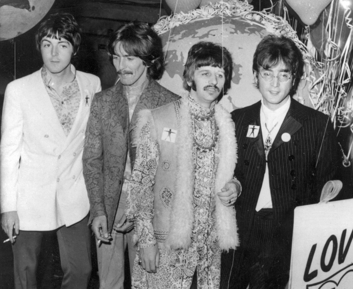 "FILE - In this June 24, 1967 file photo, The Beatles, from left, Paul McCartney, George Harrison, Ringo Starr and John Lennon, appear at EMI Studios in London. Half a century after the Beatles' psychedelic landmark, ""Sgt. Pepper's Lonely Hearts Club Band"" album, it stands as just one of many musical astonishments of 1967 that shaped what we listen to now. (AP Photo, File)"