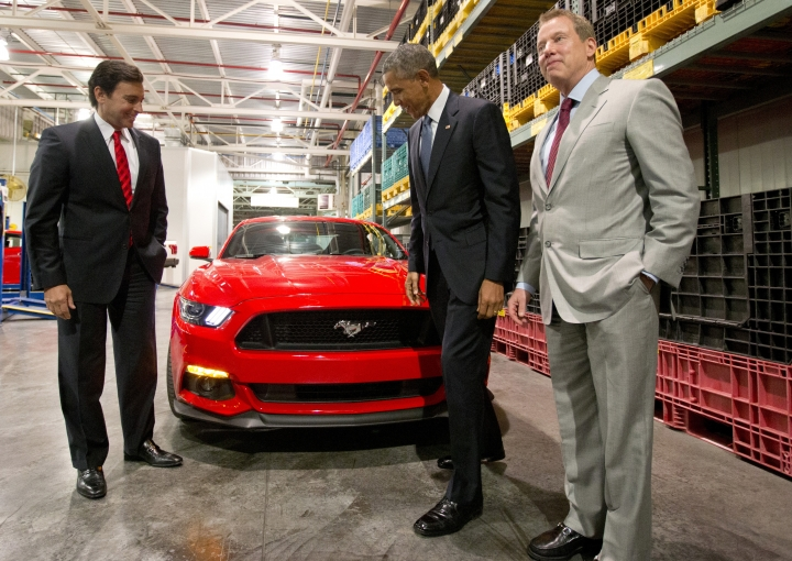 FILE - In this Jan. 7, 2015 file photo, President and CEO of Ford, Mark Fields, from left, President Barack Obama, and Bill Ford look at a new Mustang at Ford Michigan Assembly Plant in Wayne, Mich. Ford is replacing its CEO amid questions about its current performance and future strategy, a person familiar with the situation has said. Fields will be replaced by Jim Hackett, who joined Ford's board in 2013. (AP Photo/Carolyn Kaster, File)