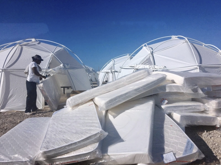 FILE - This file photo provided by Jake Strang shows mattress and tents set up for attendees of the Fyre Festival, Friday, April 28, 2017, in the Exuma islands, Bahamas. Litigation is piling up against organizers of the Fyre Festival that flamed out in a fiasco in the Bahamas in April. Lawsuits have been filed in federal courts in Los Angeles, New York and Miami in the past month as well as several state courts. (Jake Strang via AP, File)