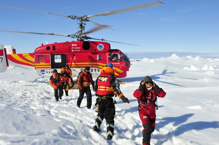 FILE - In this file photo taken Thursday, Jan. 2, 2014 and released by Xinhua News Agency, a helicopter from the Chinese National Antarctic Research Expedition or CHINARE is used to evacuate passengers, who were aboard the trapped Russian vessel MV Akademik Shokalskiy, to a safe surface off the Antarctic. Chinese officials plan to detail their ambitions in Antarctica as Beijing hosts a meeting beginning Monday, May 22, 2017 of an international group that oversees management of the polar region. (Zhang Jiansong/Xinhua via AP, File)
