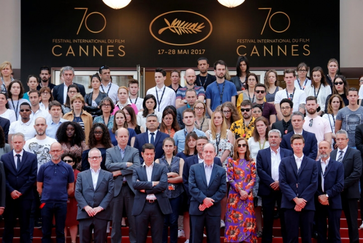 70th Cannes Film Festival - Tribute for Manchester - Cannes, France. 23/05/2017.  Cannes Film Festival general delegate Thierry Fremaux, Cannes Film festival president Pierre Lescure, actress Isabelle Huppert and staff members observe a minute of silence on the red carpet. REUTERS/Jean-Paul Pelissier