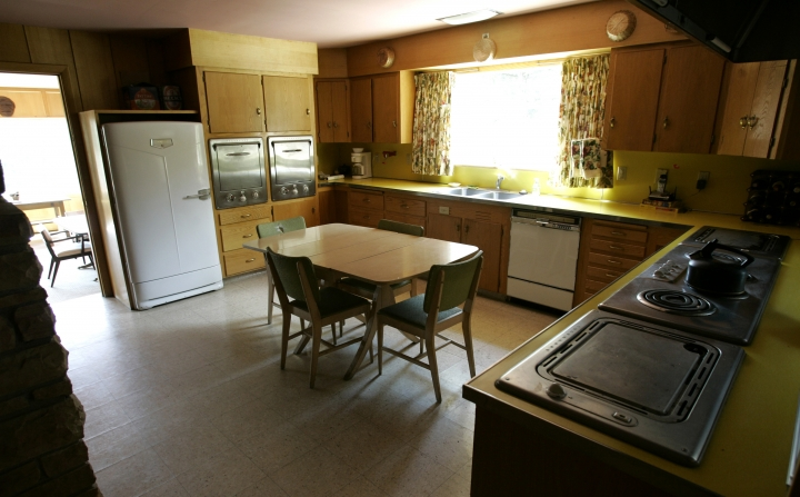FILE - This July 30, 2007 file photo shows a view of the kitchen in the house formerly owned by Ernest Hemingway outside Ketchum, Idaho. The ownership of the Idaho house where Hemingway wrote some of his last works before killing himself in the main entryway in 1961 has changed hands but will remain off limits to the public. (AP Photo/Ted S. Warren, File)