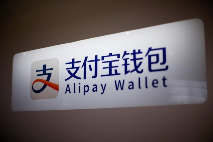 An Alipay logo is seen at a train station in Shanghai, China February 9, 2015. REUTERS/Aly Song/File Photo