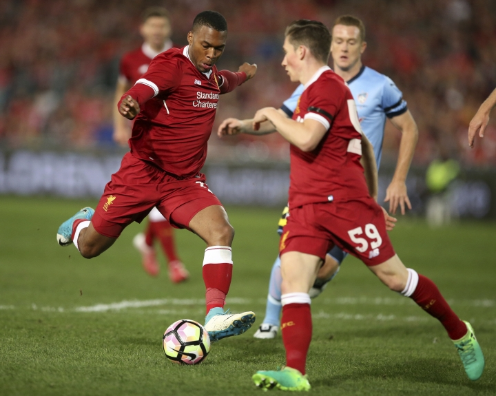 Liverpool FC's Daniel Sturridge, left, takes a shot on goal to score against Sydney FC during their soccer friendly in Sydney, Wednesday, May 24, 2017. (AP Photo/Rick Rycroft)