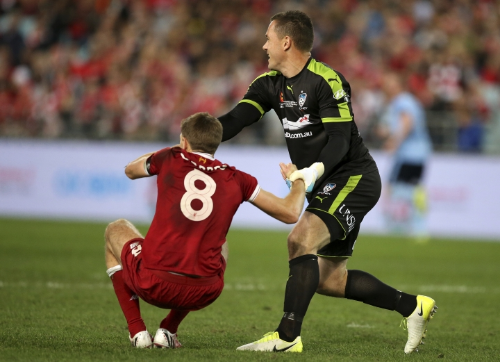 Sydney FC's Danny Vukovic, right, helps up Liverpool FC's Steven Gerrard during their soccer friendly match in Sydney, Wednesday, May 24, 2017. (AP Photo/Rick Rycroft)