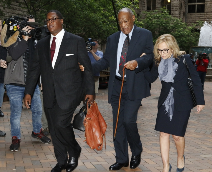 Bill Cosby, center, arrives with one of his attorneys Angela Agrusa, right, for the third day of jury selection in his sexual assault case at the Allegheny County Courthouse, Wednesday, May 24, 2017, in Pittsburgh. The case is set for trial June 5 in suburban Philadelphia. (AP Photo/Gene J. Puskar)