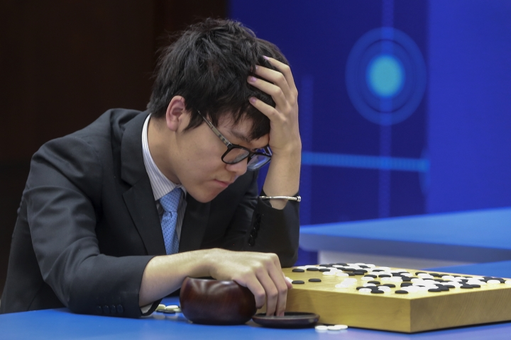 Chinese Go player Ke Jie reacts as he plays a match against Google's artificial intelligence program, AlphaGo, during the Future of Go Summit in Wuzhen in eastern China's Zhejiang Province, Thursday, May 25, 2017. A computer beat China's top player of go, one of the last games machines have yet to master, for a second time Thursday in a competition authorities limited the Chinese public's ability to see. (Chinatopix via AP) CHINA OUT