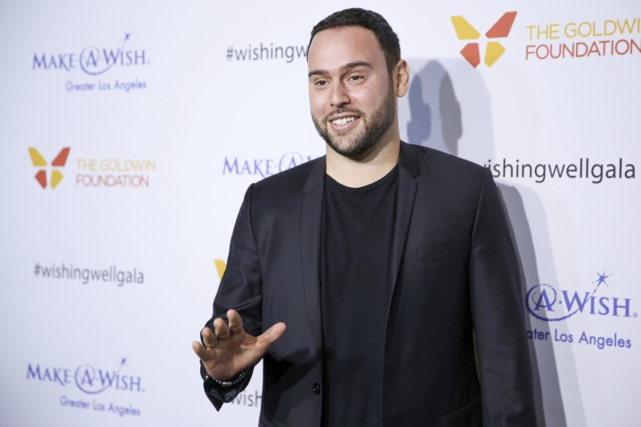 """FILE - In this Dec. 7, 2016, file photo, Scooter Braun arrives at the 4th Annual Wishing Well Winter Gala at the Hollywood Palladium in Los Angeles. Braun tweeted on May 25, 2017, that he plans to honor those lost during the bombing of Ariana Grande's Manchester, England, concert with """"love and joy and life."""" (Photo by Rich Fury/Invision/AP, File)"""