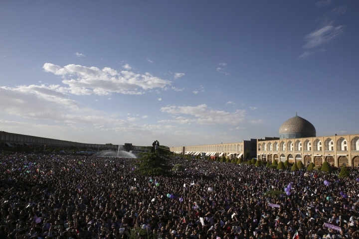 In this picture taken on Sunday, May 14, 2017, supporters of Iranian President Hassan Rouhani in the May 19 presidential election attend his campaign rally, in front of the Sheikh Lotfollah Mosque in the city of Isfahan, Iran. For Iranian President Hassan Rouhani, winning re-election may have been the easy part. His wide-margin victory over a hard-line rival shows a majority of Iranian voters prefer his promises of greater liberalization at home and deeper engagement with the world. (AP Photo/Vahid Salemi)