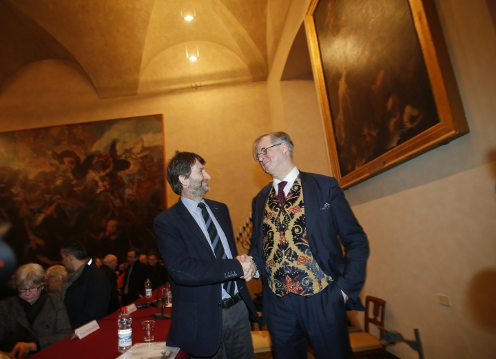 FILE - In this Thursday, Jan. 21, 2016 file photo, James Bradburne, Milan's Brera Art Gallery director, right, shakes hand with Italian Minister of Culture Dario Franceschini at the end of a news conference in the Sala Passione hall of the gallery, in Milan, Italy. An Italian administrative court has nixed the selection of five museum directors, siding with critics of a much-vaunted reform which allowed experts based abroad to compete for top posts. Culture Minister Dario Franceschini on Thursday, May 25, 2017 slammed the ruling by the Lazio region's administrative tribunal as an embarrassment to Italy. His ministry immediately launched an appeal to the Council of State, the highest administrative tribunal. (AP Photo/Luca Bruno, File)