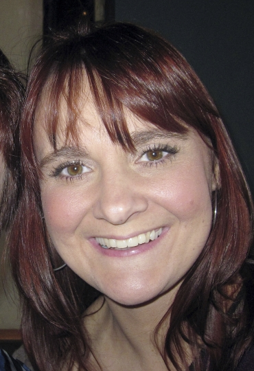 Undated handout photo issued by Greater Manchester Police on Thursday May 25, 2017 of Elaine McIver, who has been named as the off-duty police officer who died in the Manchester bombing. McIver, who served with Cheshire Police, was at the Ariana Grande concert with her partner, Paul, who was wounded in the deadly explosion. (Greater Manchester Police via AP)