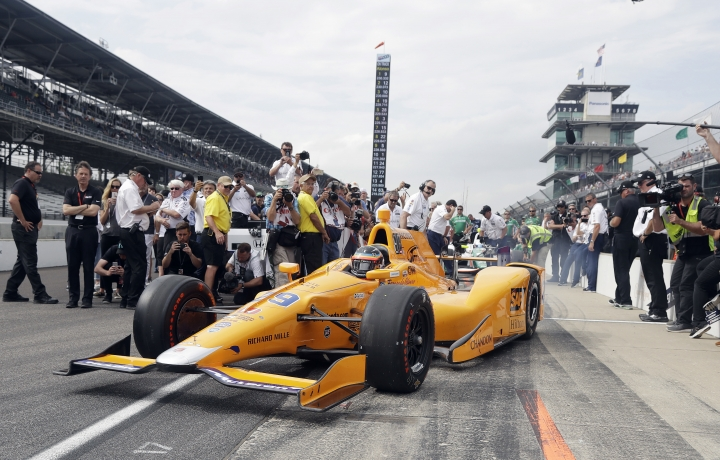 "FILE - In this May 20, 2017, file photo, Fernando Alonso, of Spain, pulls out of the pits during qualifications for the Indianapolis 500 IndyCar auto race at Indianapolis Motor Speedway, in Indianapolis. A year after the biggest celebration in the history of the Indianapolis 500, much of the buzz around the 101st running of the race involves the debut of a well-decorated ""rookie"": Two-time Formula One champion Fernando Alonso. (AP Photo/Darron Cummings, File)"