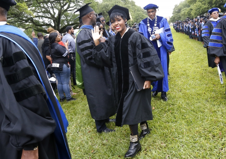 "In this Saturday, May 13, 2017 photo, actress and singer Janelle Monae arrives before a graduation ceremony at Dillard University in New Orleans. Dillard University graduates more physics majors - and, notably, more female physics majors - than far bigger schools with more resources. The point was punctuated at Dillard's recent commencement exercises, with a keynote address from Monae, a star of ""Hidden Figures."" (AP Photo/Gerald Herbert)"