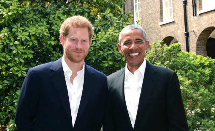 In this handout photo issued by Kensington Palace, Britain's Prince Harry, left, poses for a photo with former US President Barack Obama following a meeting at Kensington Palace in London, Saturday May 27, 2017. Obama has offered his condolences to victims of the Manchester bombing during a meeting with Prince Harry. The prince's Kensington Palace office tweeted a picture of Harry and Obama at the palace Saturday. (Kensington Palace via AP)
