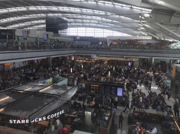 In this image taken from the twitter feed of Emily Puddifer, a view of Terminal 5 departure lounge, at London's Heathrow airport after flights were canceled due to the airport suffering an IT systems failure, Saturday, May 27, 2017. British Airways canceled all flights from London's Heathrow and Gatwick airports on Saturday as a global IT failure upended the travel plans of tens of thousands of people on a busy U.K. holiday weekend. (Emily Puddifer via AP)
